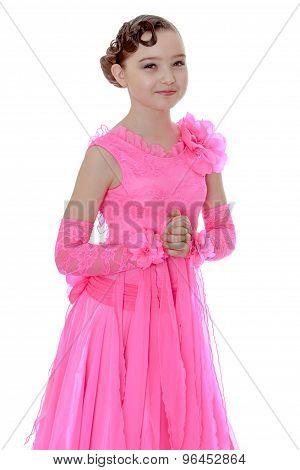Girl dancing in a long pink dress