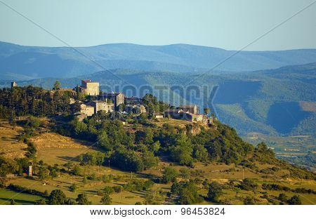 The medieval buildings on a hill in the evening