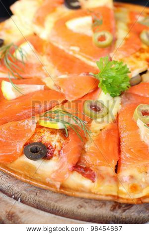 salmon Pizza is cut into ready to eat.