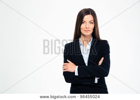 Beautiful businesswoman standing with arms folded isolated on a white background. Looking at camera