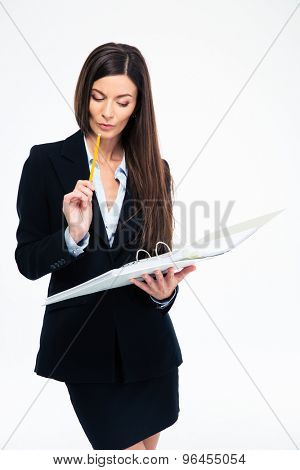 Pretty businesswoman reading documents in folder isolated on a white background