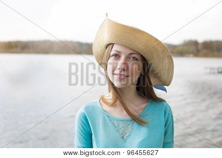 Freckled Girl In Hat Looking At Camera And Smiling