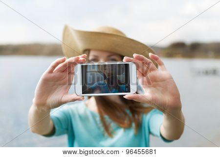 Girl In Hat Taking Her Photo