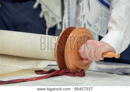 Torah Scroll With A Man's Hand
