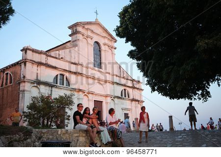 Tourists Sightseeing Saint Eufemia Church