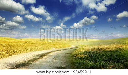dusty steppe road and blue sky