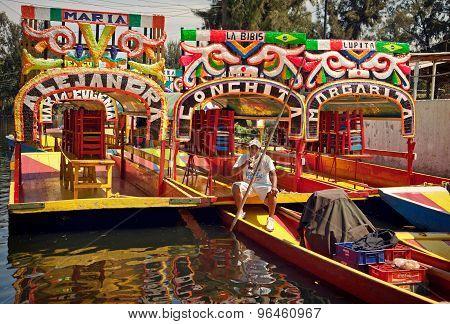Local Boat Driver Taking Rest On His Gondola In Xochimilco Of Mexico