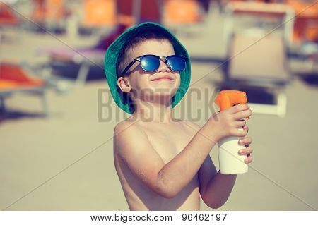 Little Boy Applying Sunscreen Spray Vintage