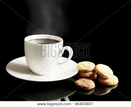 Cup Of Coffee With Cookies And Saucer On Black