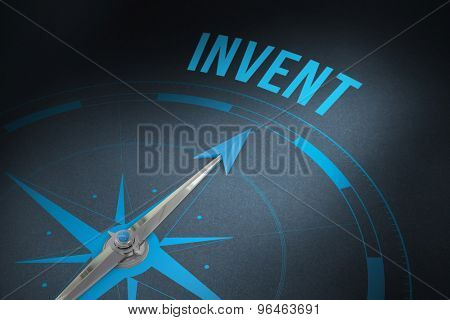 The word invent and compass against grey background