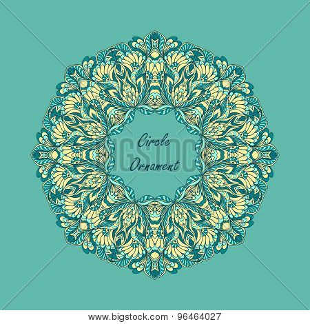 Circle ornament from doodle flowers on blue background