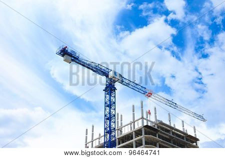 Construction crane and concrete building construction