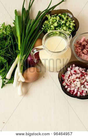 Okroshka.- Ingredients For Making Hash - Radishes, Cucumbers, Sausage, Serum