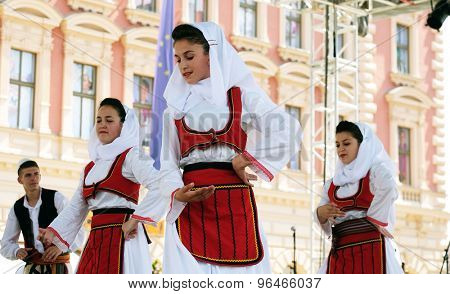 ZAGREB, CROATIA - JULY 19: Members of folk group Deshmoret e Kombit from Pristina, Kosovo during the 49th International Folklore Festival in center of Zagreb, Croatia on July 19, 2015