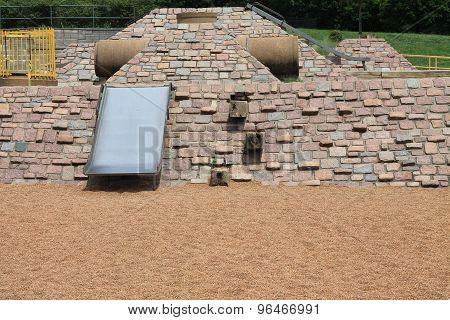 Vintage playground with metal slide and rocks