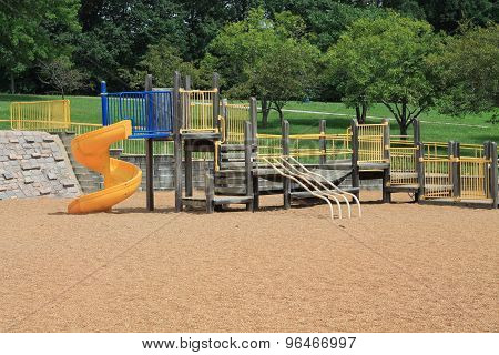 Playground with yellow slide
