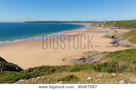 The Gower peninsula South Wales sandy beach and blue sea in summer