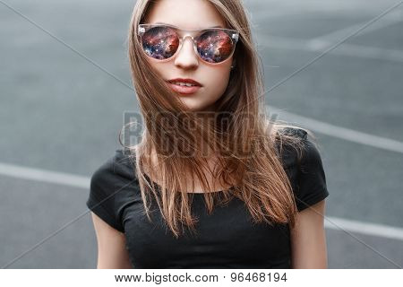 Beautiful Girl In Sunglasses. In The Glasses Reflection Of Space.