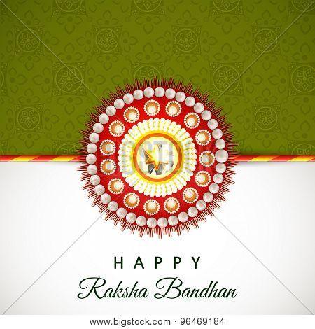 Beautiful shiny rakhi on floral design decorated green and grey background for Indian festival, Raksha Bandhan celebration.