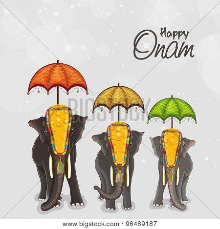 Beautifully decorated elephants with umbrella on shiny grey background for South Indian festival, Happy Onam celebration.