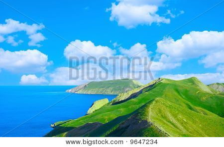 Mountain Ridge And Blue Sea Gulf