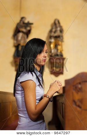 Woman Prays In A Church