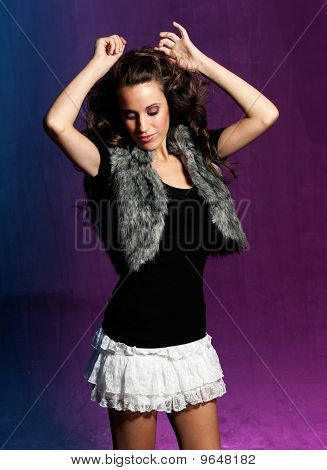 Young Girl Dancing At Disco. Blue And Purple Background.