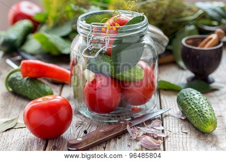 Vegetables And Herbs In The Glass Jar On A Wooden Table.