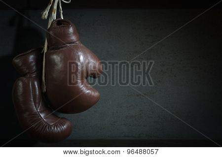 Old Used Boxing Gloves, Hanging Before A Dirty Wall