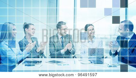 business, technology, success and people concept - happy business team with laptop computers, documents and coffee clapping hand over blue squared grid background