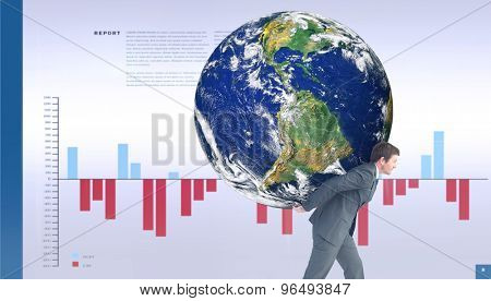 Businessman carrying the world against business interface with graphs and data