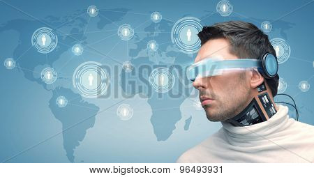 people, technology, future and progress - man with futuristic glasses and microchip implant or sensors over blue background with world map and network contacts icons