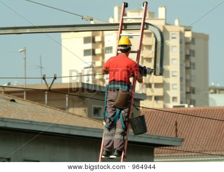 High Voltage Electrician Working In The High Voltage Cables