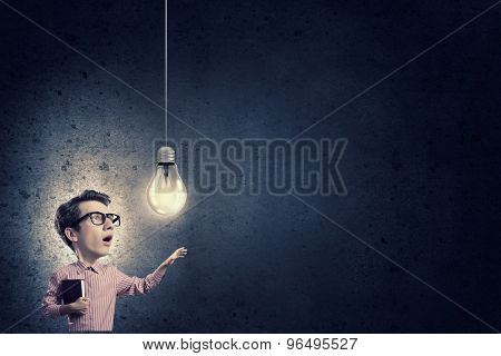 Young funny man in glasses with big head
