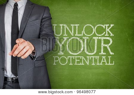 Unlock your potential on blackboard with businessman