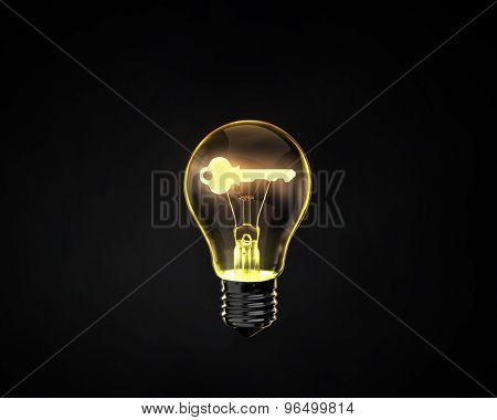 Light bulb with key inside on dark background