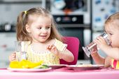 image of daycare  - Cute little children drinking water at daycare or nursery - JPG