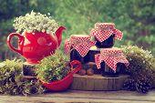 image of teapot  - Red teapot tea cup and jars of healthy jam - JPG