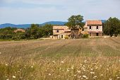 picture of stone house  - Stone house in a harvested field Provence France - JPG