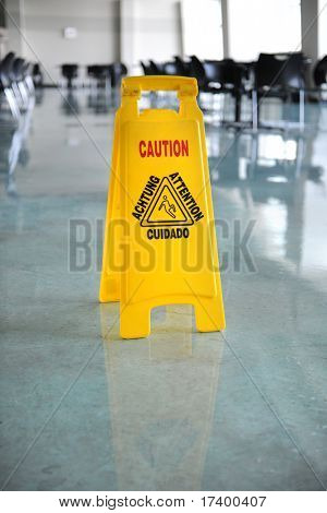 Wet floor caution sign on floor