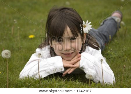 Young Girl On A Dandelion Field