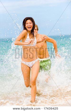 A young couple having fun on a tropical beach