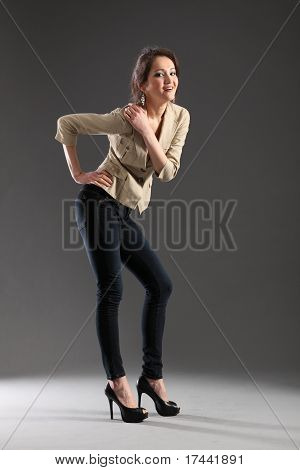 Sexy pose from girl in skinny jeans