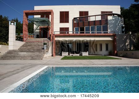 swimming pool in front of the house