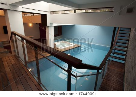 swimming pool and jacuzzi tub in luxury apartment