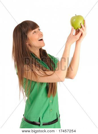 Beautiful smiling young woman holding a green apple, studio shot.