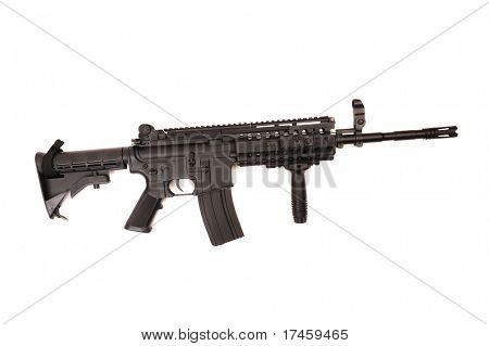 Full length automatic assault rifle isolated on white.