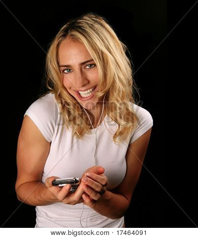Lovely Girl Listening to Downloaded Music on an MP3 Player
