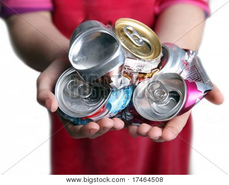 Young Child Holding Crushed Aluminum Cans Representing Concept to Recycle for Their Future