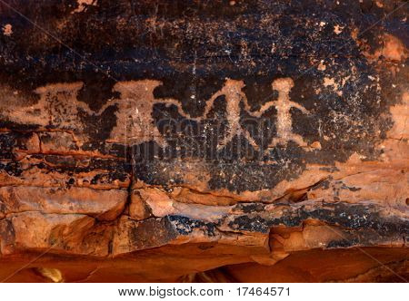 Native American Petroglyphs in Red Sandstone From the Southwestern Desert